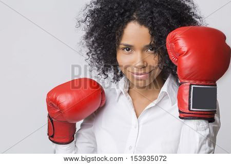 Smiling African American Girl In Red Boxing Gloves In The Air