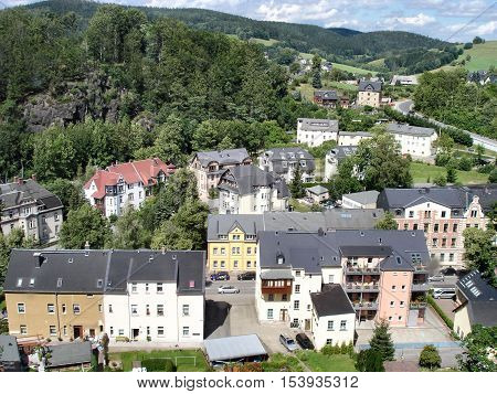 View from the bird's eye view of Schwarzenberg in the Erzgebirge in Saxony, Germany; the small town is surrounded by wooded hills