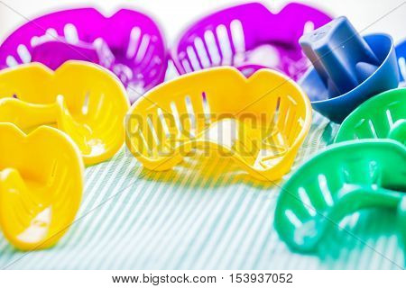 Close up photo of colorful dental impression trays