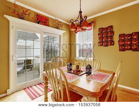 Bright dining room interior in red colors with french door to the back yard. Northwest USA
