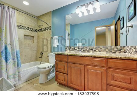 Blue Bathroom Interior With Mosaic Back Splash