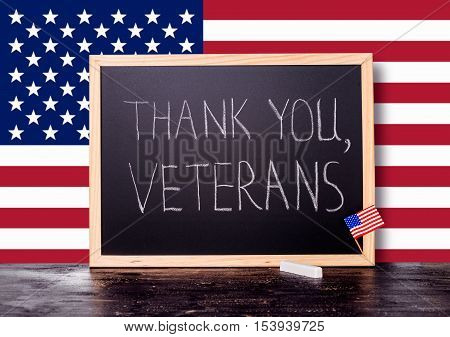 Greeting Card Of Handwriting Text Thank You Veterans Is Written In Chalkboard With Flag United State