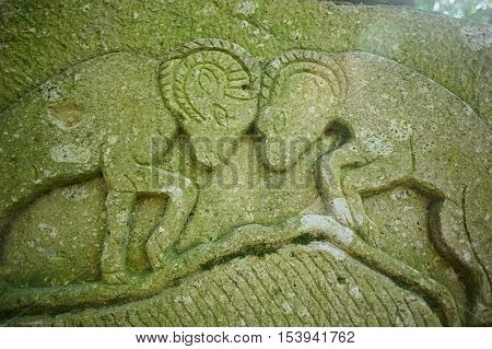 The bas-relief sheep butting heads on the stone. Vintage