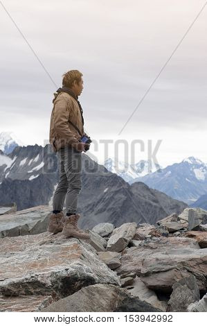 Male Model Posts From The Top Of Snowcapped Mountain Peak Around Aoraki Mount Cook And Mount Cook Na