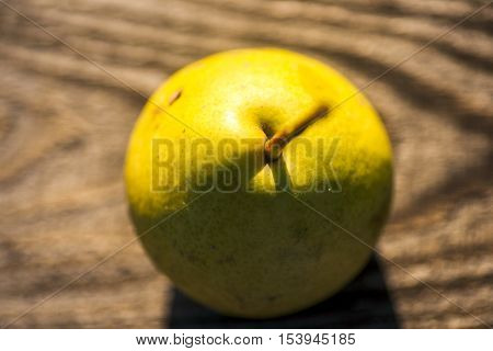 Fresh pears. On the wooden background. Free space for text . Top view