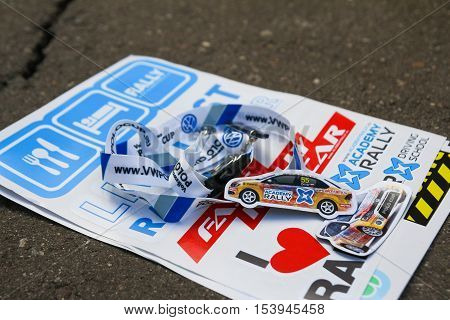 Moscow Russia - Apr 18 2015: VW Polo Cup stickers and trinkets lie on a asphalt during the Rally Masters Show 2015 at the Krylatskoye District.