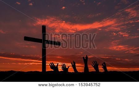 Group of hands reach up to a black cross for salvation.