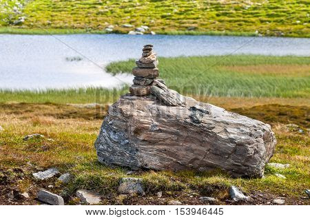 Stone cairn as a navigation mark on the Norwegian mountain