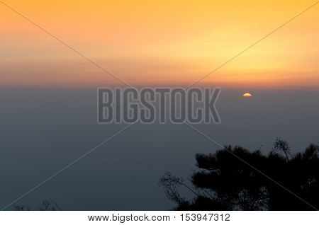 The sun rising over the Taishan Mountain range in Shandong province China.