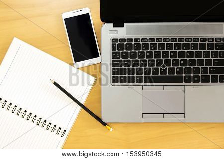 Top view of office Table top with laptop computer mobile smartphone.