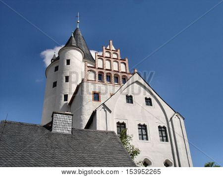 The Schwarzenberg Castle in Erzgebirge in Saxony, Germany,  partial view and keep, sunny day with blue sky,