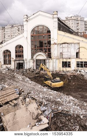 Excavators destroying the building in the center of Moscownear the Patriarchal bridge