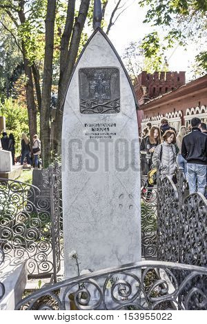 Moscow Russia -September 102016: Novodevichye Cemetery. The grave of Anton Chekhov. Customers visiting the grave