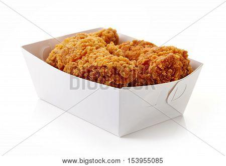 Fried Breaded Chicken Wings In White Cardboard Box