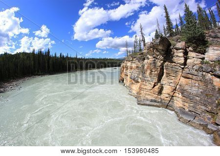 Wild and babbling Athabasca River in Jasper National Park, Alberta, Canada