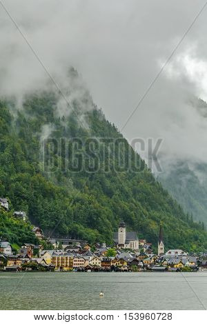 View of Hallstatt village from Hallstatt lake in rainy weather Austria