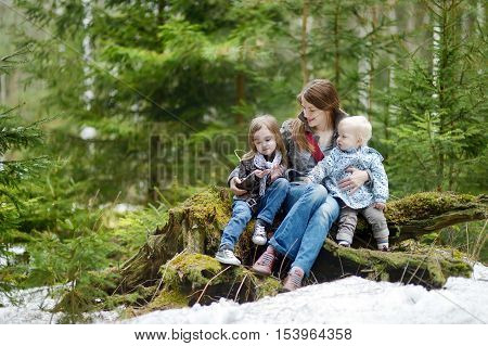 Young Mother And Her Two Daughters Outdoors