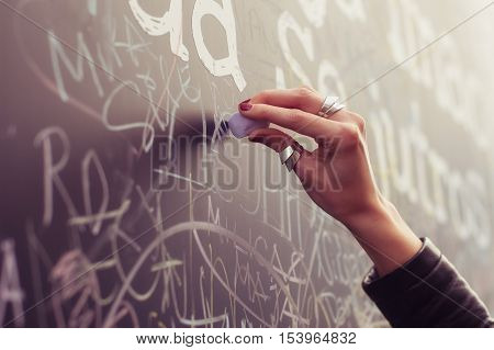 Hand writing with chalk on full filled board. Close up