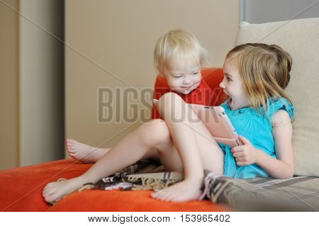 Two Children Playing On A Digital Tablet