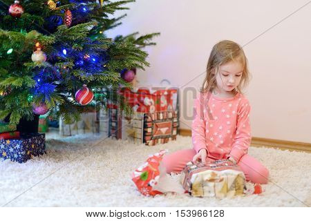 A Girl Unwrapping Presents On Christmas Morning