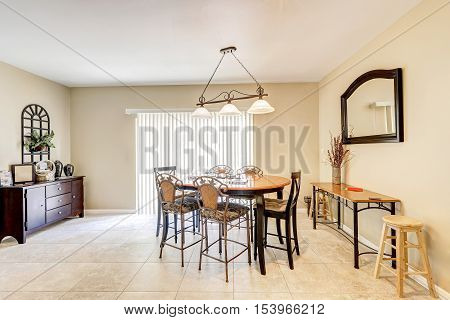 Bright And Light Dining Room With Bar Style Chairs And Tile Floor