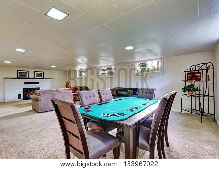 Entertainment Room With Fireplace And Poker Table