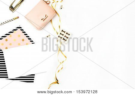 Table view office items white background mock-up woman desk. Office desktopgold items. Flat lay. Invitation template gold polka. Open envelope