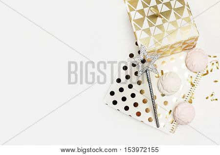 Party background mockup. Flat lay. Notebook polka gold with cakes and magic star confetti. Header for site or Hero