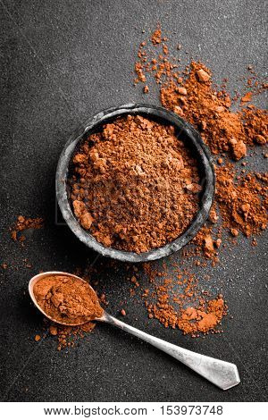 cocoa powder, ground chocolate in bowl close up