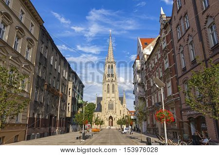 KATOWICE POLAND - JULY 28 2015: St. Mary's Street (Polish: Ulica Mariacka) and St. Mary's Church (Kosciol Mariacki) in Katowice