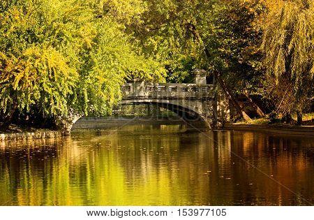 Autumn in Bucharest. Lake and bridge in Cismigiu Park.