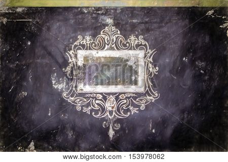Decorative white swirly label on a black background with painted distressed texture