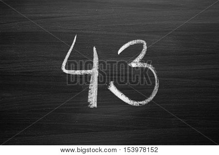number forty three enumeration written with a chalk on the blackboard