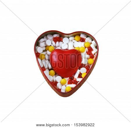 box of pills and red heart on white background isolated