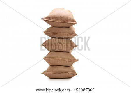 Stack of burlap sacks isolated on white background