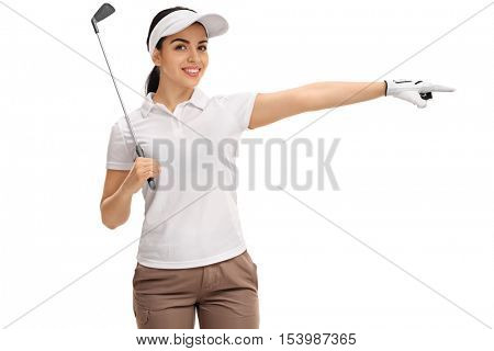 Cheerful female golfer holding a golf club and pointing right isolated on white background