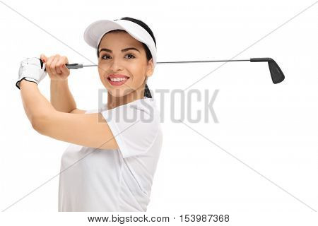 Cheerful female golf player swinging a golf bat isolated on white background