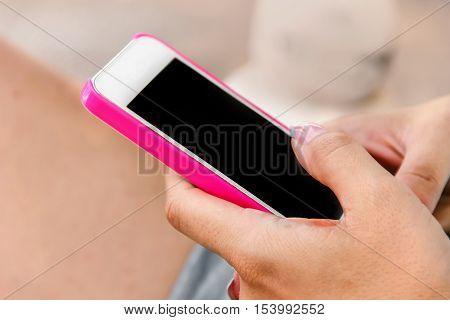 woman holding a smart phone send SMS internet 4 G