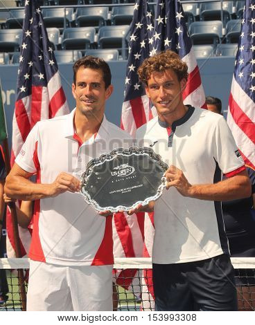 NEW YORK - SEPTEMBER 10, 2016: US Open 2016 men doubles runners up Guillermo Garcia-Lopez (L) and Pablo Carreno Busta of Spain during trophy presentation at the Billie Jean King National Tennis Center