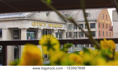 Boston, Massachusetts, USA - May 4, 2014: Quincy Market is a historic market complex near Faneuil Hall in downtown Boston, Massachusetts, USA. Focus on