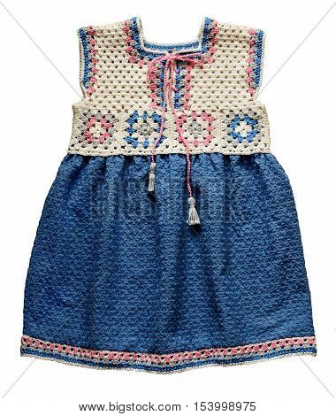 Crochet baby dress with grandma's squares and blue embroidered fabric