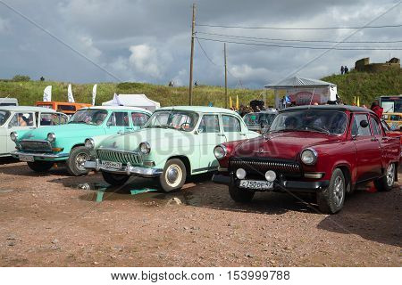KRONSTADT, RUSSIA - SEPTEMBER 04, 2016: Three Soviet car Volga GAZ-21 at the exhibition of retro cars in Kronstadt