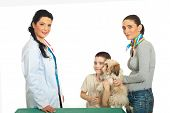 Family with puppy shih tzu visit veterinary doctor woman against white background poster