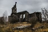 An old abandoned decayed wooden Church of the Intercession of the Holy Virgin in the village Aldia, Tambov region, Russia poster