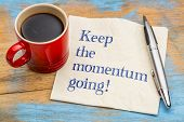 Keep the momentum going - handwriting on a napkin with a cup of espresso coffee poster