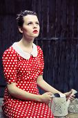 Retro dressed girl with a watering can