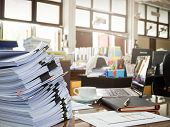 Business Concept Pile of unfinished documents on office desk Stack of business paper poster