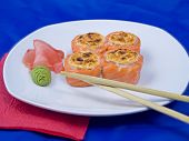 Photo of a rolled and sushi on blue bacground poster