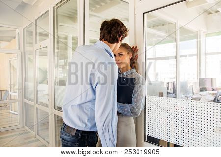 Formal Man And Woman Flirting While Standing In Hall Of Office Building Having Adultery