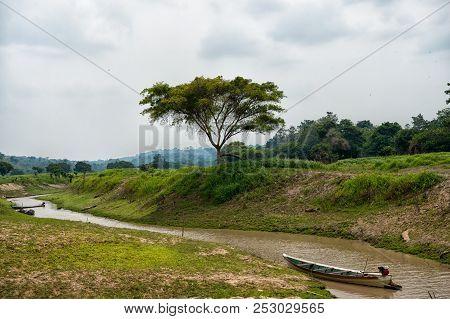 Boat On Amazon River In Boca De Valeria, Brazil. Amazon River Flow On Tropical Landscape On Cloudy S